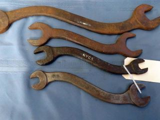 4 marked railroad wrenches