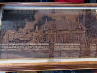 framed carved wooden locomotive by Kim Murray