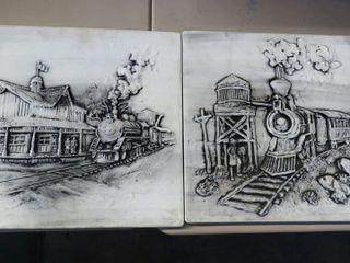 2 concrete locomotive art pieces