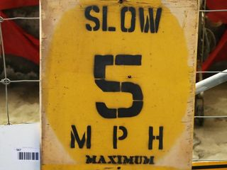 wooden single sided speed limit sign