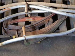 5 scythe handles with blades