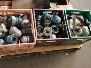 3 milk crates of insulators