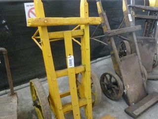 painted yellow wooden baggage cart