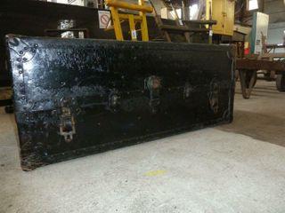 painted black steamer trunk