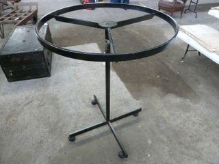 metal round clothing rack on castors