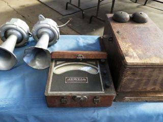 box containing  ringer box  volt meter  2 horns