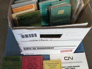 box of railroad timetables