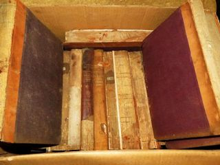 box of early hardcover books