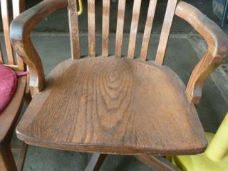 wooden armed swivel chair
