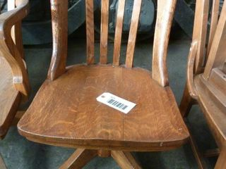 wooden swivel chair on castors