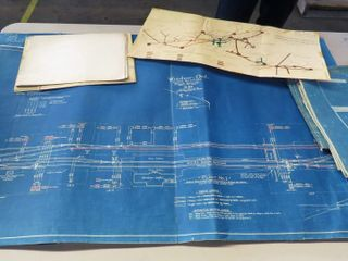 large railroad blueprints and one map