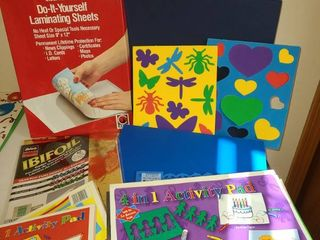 Assorted craft items laminating sheets activity pads foam shapes