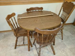 Dining Table 30 x 35 x 35 in with 1 leaf Approximately 8 in Wide and 4 Wood Dining Chairs