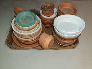Various Sizes of plant saucers   water catchers