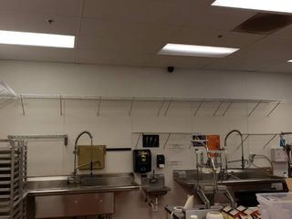 Wall shelving above sinks