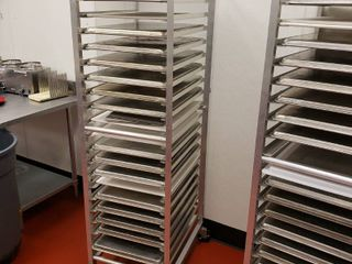 Aluminum sheet pan rack with 15 cookie sheets and 3 cutting boards