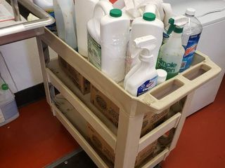 Utility cart with cleaning chemicals