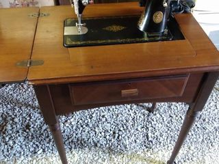 singer sewing machine in cabinet
