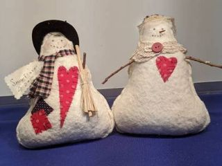 Mr and Mrs snowman selling snowflakes