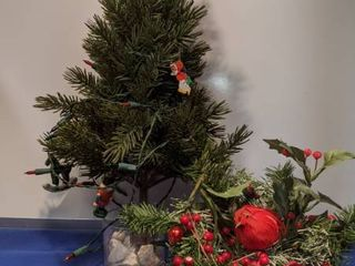 Christmas tree and centerpiece tree needs more rocks in cup to stand up lights works