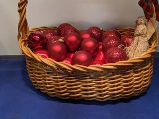 Christmas basket full of red ornaments