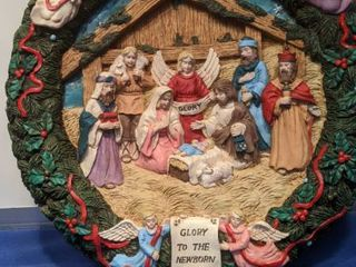 Nativity in wreath scenery plays music when motion activated