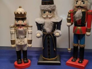 three nutcrackers one without the staff