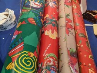 seven rolls of leftover Christmas paper these are not new rolls
