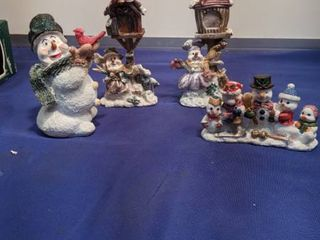 four snowman figurines