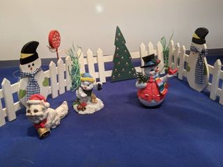 Holiday fence and figurines