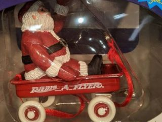 Santa in a red radio flyer Christmas ornament new in box
