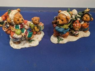 two bear figurines one has piece broken