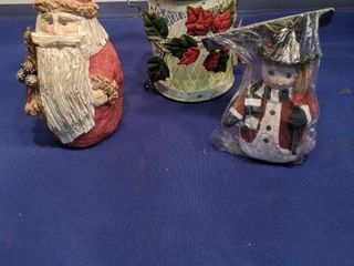 Santa candle holder and snowman