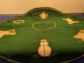 33  round felt and hand accented Christmas tablecloth