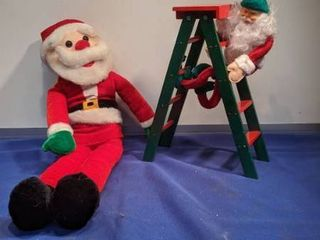 two Santa s one climbing and ladder