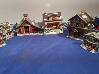 6 piece village set three big pieces that lights up and three small pieces untested
