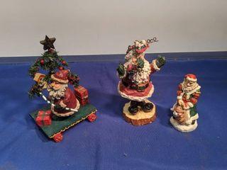 three Santa s figurines