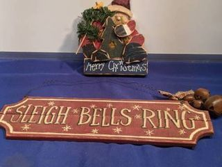 two Christmas signs