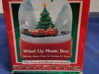 musical snow globe wind up music box plays Santa Claus is coming to Town the train goes around and around