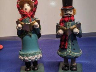 two Christmas carolers