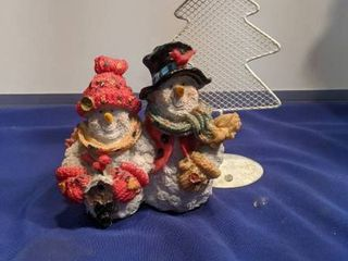 snowman figurines and candle holder