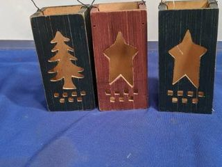 three wooden candle holders