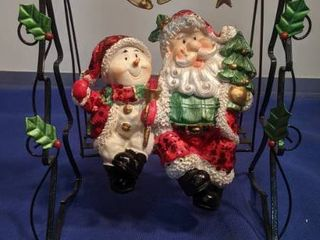 snowman and Santa in her swing