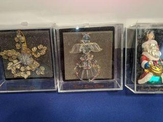 three hand spun glass ornaments