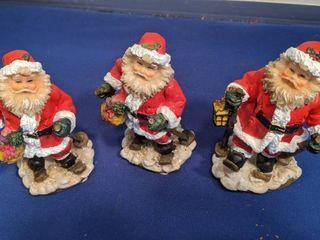 three Santa figurines