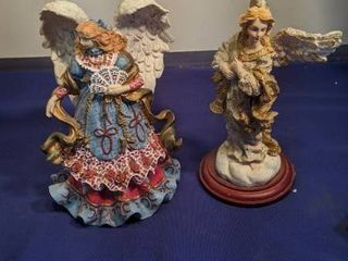 two angel figurines