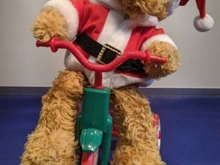 Bear on tricycle rides and plays music