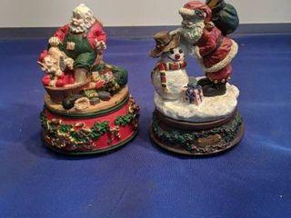 2 Santa musical figurines