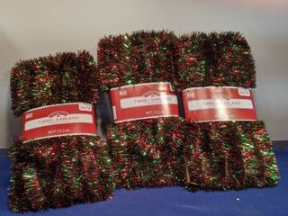 three packages 40 ft tinsel garland new in package