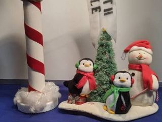 North Pole sign and penguins and snowman lights up needs batteries